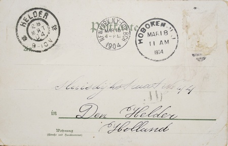 Vintage postcard of 1904 with no stamp but with postmarks in Hoboken New Jersey, New York and Rotterdam. Address in Den Helder, The Netherlands Stock Photo - 9144379