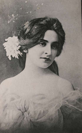 victorian valentine: Original postcard of gorgeous young woman in 1910 in black and white Editorial
