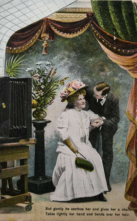 Old fashioned love, couple in photostudio- circa 1904 hand-tinted photograph as postcard Stock Photo - 9158227