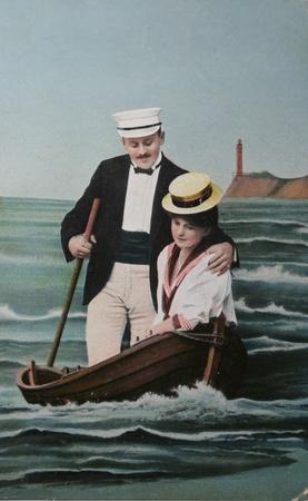 Nostalgic love- lovers in fake rowingboat-circa 1909 postcard, Stock Photo - 9158223