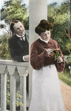 UK-CIRCA 1908: Victorian romance - loving couple on a  hand-tinted photograph postcard, circa 1908