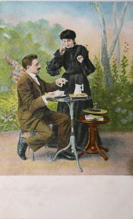 Loving couple drinking tea in garden surroundings - circa 1905 hand-tinted photograph postcard,