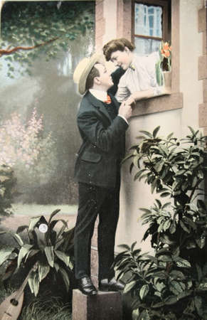 Victorian romance - loving couple  - circa 1907  hand-tinted photograph postcard,