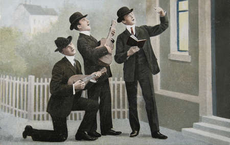 victorian valentine: old postcard of 1905 with three men making music Editorial