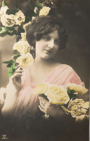 classic woman: GERMANY-CIRCA 1913: Lovely young girl with yellow roses, circa 1913 Editorial