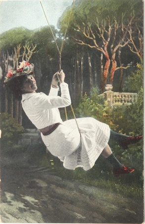 FRANCE-CIRCA 1908: young woman happy smiling on a swing , circa 1908