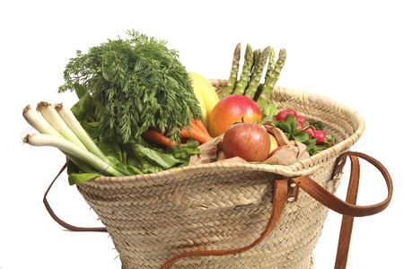 shopping bag filled with organic vegetables and fruit photo