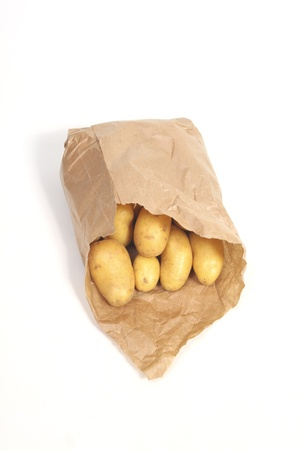 unpeeled: New unpeeled potatoes in paper bag