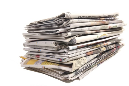 everyday jobs: Stack of Dutch newspapers on white
