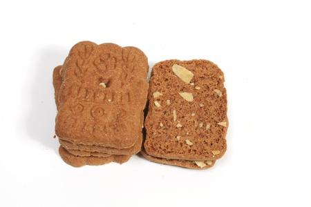 Stack of almond speculaas cookies. Speculaas is a Dutch traditional cookie speciality photo