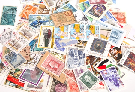 THE NETHERLANDS-APRIL 2011: Collection of international postage stamps on a bunch Stock Photo - 9311064