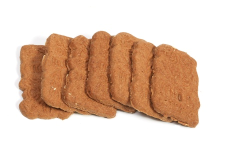 Row of almond speculaas cookies. Speculaas is a Dutch traditional cookie speciality photo