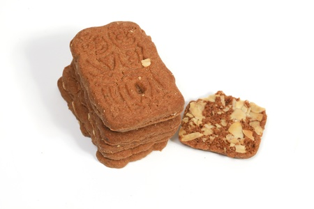 Stack of almond speculaas cookies. Focus on the big stack photo