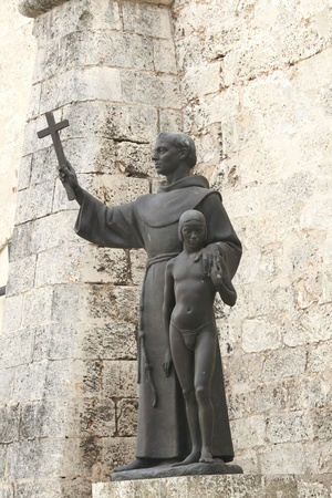 Statue of Francis of Assisi with cross and young boy in Havana, Cuba photo