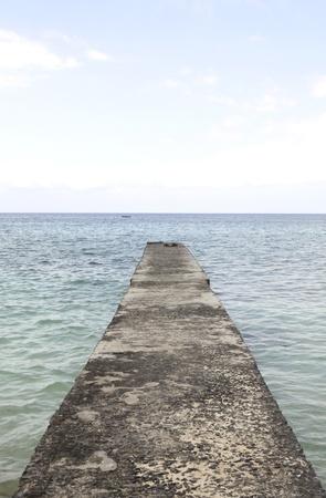 Pier in the Caribbean ocean photo