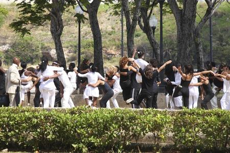 cuban women: HAVANNA, CUBA-FEBRUARY 21, 2011: Young people dancing in a park in Havanna in Cuba on a movie take