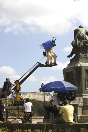 HAVANNA, CUBA-FEBRUARY 21, 2011: Cameraman and movie crew making a movie in Havana, Cuba on april 21, 2011