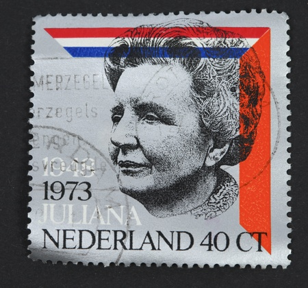 reign: THE NETHERLANDS-CIRCA 1973: Stamp issued in the Netherlands for the silver jubilee of the reign of Queen Juliana, circa 1973