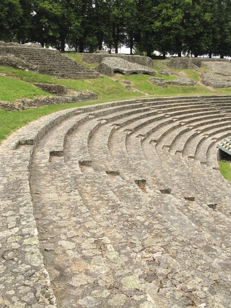 Benches in an ancient Roman theatre in Autun, France. Biggest roman theatre in France. It was build during the reign of Emperor Augustus for 16.000 spectators Stock Photo - 9625236