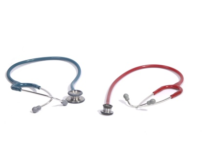 Small red stethoscope for children and big adult stethoscope on the left photo