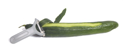 Peeling the skin of a cucmber  Stock Photo