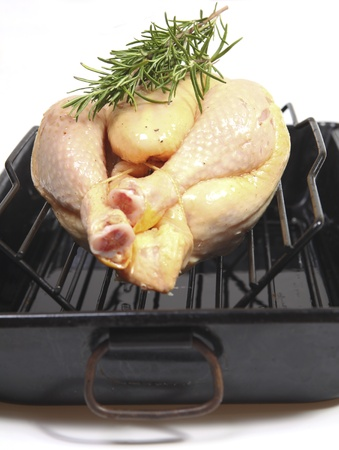 Baking a chicken in a tray photo