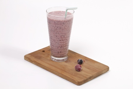 mixed berries: Blueberry and raspberry smoothie on wooden plate
