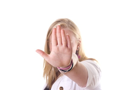 Girl holding hand up saying stop. No face visible Stock Photo - 9888955