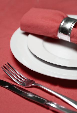 dish cloth: table setting with plates, napkin, silverware in a bright red color Stock Photo