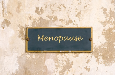 seniority: Sign on medieval wall with word Menopause Stock Photo
