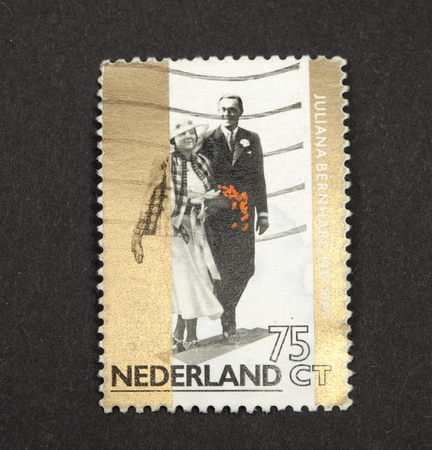 reign: THE NETHERLANDS-CIRCA 1987: Stamp issued  in 1987 in the Netherlands for the golden jubilee of the wedding  of Queen Juliana with Prince Bernhard von Lippe Biesterfeld in 1937