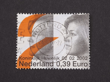 heir: THE NETHERLANDS-2002: Stamp issued  in 2002 in the Netherlands to comemmorate the royal wedding between the heir to the throne of the Netherlands Prince Willem Alexander and Argentinian Maxima Zorreguita  on 02-02-2002  Editorial
