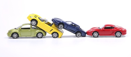 Toy cars in a simulated chain crash Stock Photo