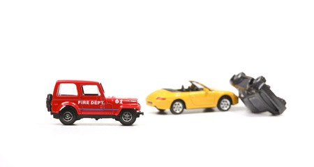 pile engine: Car crash between a yellow sportscar and a black sedan with fire dept car. Simulation with model cars