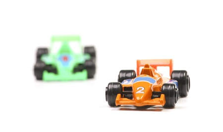 toy car: Two racing cars. Focus on the winning orange race car. Stock Photo