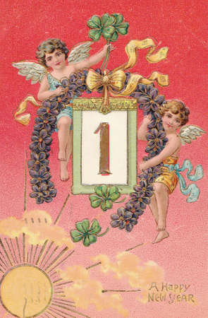 best wishes: GREAT BRITTAIN- CIRCA 1903: Antique postcard with illustration of two angels and four leaf clovers  and text  A Happy New Year, circa 1903 Editorial