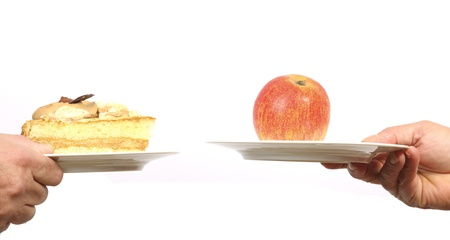 Making a choice between an apple and a piece of cake photo