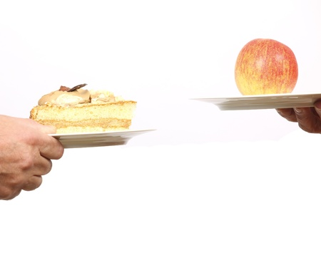 hand weight: Making a choice between an apple and a piece of cake