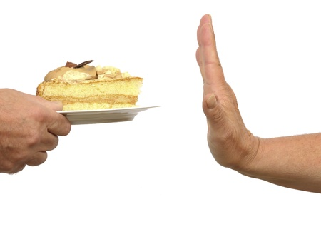 reject: Hand gesturing stop to a cake on a plate