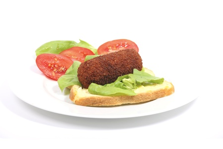 A plate with croquette and bread. Some salad on the side. Stock Photo - 10699284