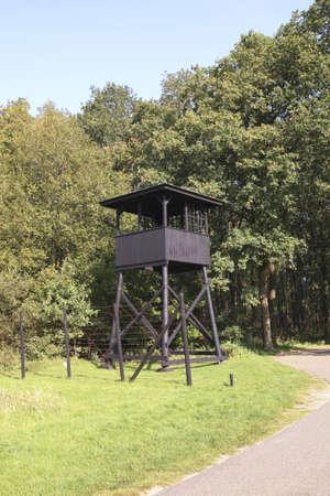 detention: HOOGHALEN, NETHERLANDS -OCTOBER 2: Watchtower at former concentration camp Westerbork on July 10, 2011 in Hooghalen, Netherlands. Westerbork was a World War II Nazi refugee, detention and transit camp.