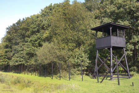HOOGHALEN, NETHERLANDS -OCTOBER 2: Watchtower at former concentration camp Westerbork on July 10, 2011 in Hooghalen, Netherlands. Westerbork was a World War II Nazi refugee, detention and transit camp.