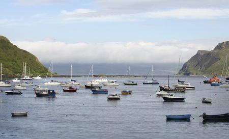 Boats lying in the harbor of Portree on the Isle of Skye