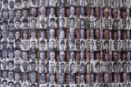 NEW YORK CITY, NY - SEPT 9: Wall with pictures of immigrants at Ellis Island  on Sep 9, 2011. Ellis Island was the gateway for millions of immigrants to the United States from 1892 to 1954.