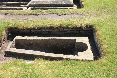 Empty grave at the medieval cemetary of St. Andrews in Scotland Stock Photo