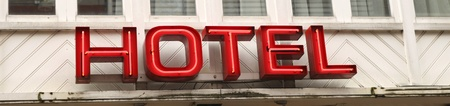 Hotel sign in red neon letters photo