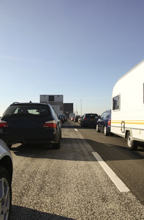 Cars waiting in front of an open bridge on a freeway  in the Netherlands Stock Photo - 10952210