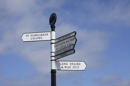 upper half: Signs with directions to different areas inside the Edinburgh Castle in Scotland