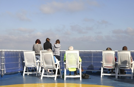 ijmuiden: IJMUIDEN, THE NETHERLANDS- JULY 10: People on the sundeck of DFDS Seaway ferry between the Netherlands and Newcastle, England  watching the ocean from the sundeck on Jul 10, 2011. DFDS offers daily departures from IJmuiden to Newcastle and vv and transpor Editorial