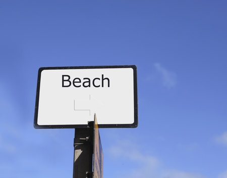 directed: Sign with text beach and right directed arow in Great Brittain